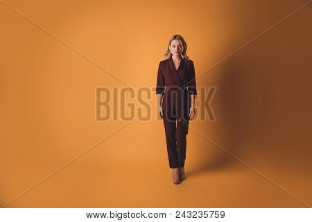 Full Size, Body Portrait Of Serious Confident Woman In Overalls Looking At Camera Standing Isolated