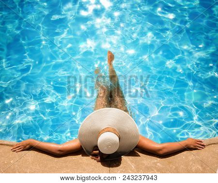 Young And Beautiful Woman Relaxing In The Pool