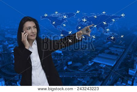 Business Woman Talking On Her Cell Phone And Pointing Finger To World Map With Flight Routes Airplan