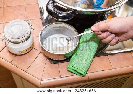 Person Holding Spoonful Mixed Baking Soda, Effective Natural Cleaning Agent