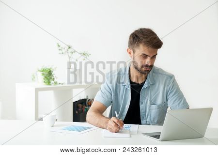 Serious Financial Manager Working At Laptop In Office, Analyzing Company Statistics, Comparing Diagr