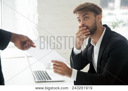 Frustrated Shocked Caucasian Male Worker Getting Dismissal Notice From African American Boss Asking
