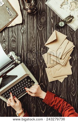 Partial View Of Writer Typing On Typing Typing Machine With Blank Envelopes On Wooden Tabletop