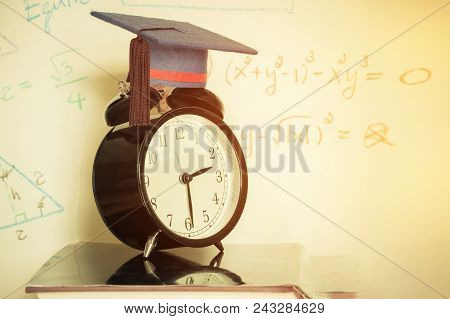 Graduation Cap On Top Retro Alarm Clock With Math Formula Equation Graph On Screen Classroom. Ideas