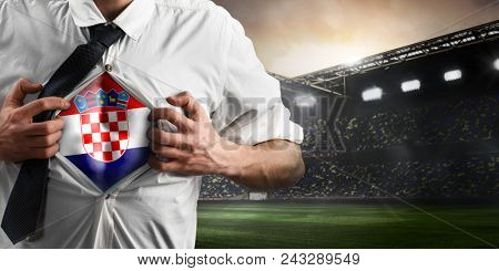 Croatia soccer or football supporter showing flag under his business shirt on stadium.