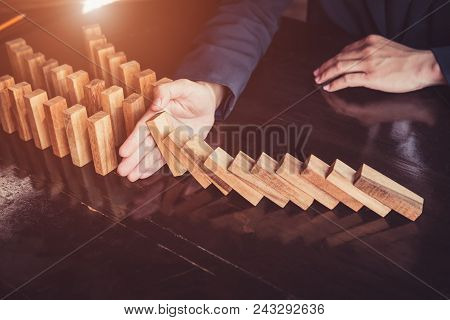 Business Man Placing Wooden Block On A Tower Concept Risk Control, Planning And Strategy In Business