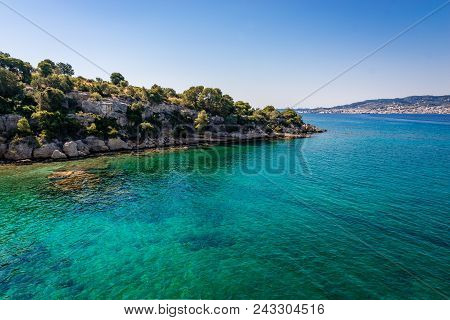 A Scenic Coastline In Peloponnese, Greece, With The Island Of Spetses In The Background.