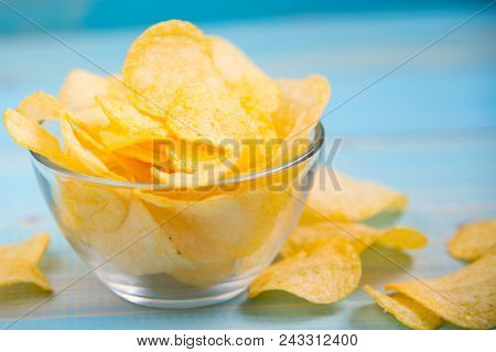Crispy Potato Chips In A Glass Bowl On Old Kitchen Table Potato Chips On  A Table. Concept Of Unheal