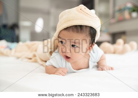 Portrait Of A Crawling Baby On The Bed In Her Room, Adorable Baby Boy In White Sunny Bedroom, Newbor
