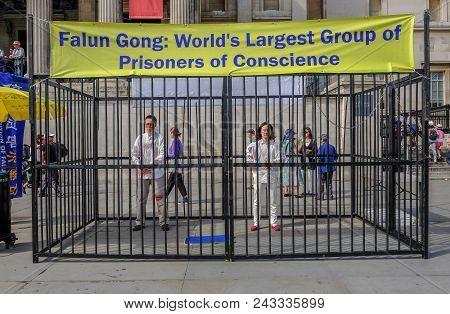 Trafalgar Square, London, England, Uk - April 22, 2018: Falun Gong, Prisoners Of Conscience Protesti