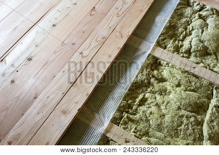 Installation Of New Floor Of Wooden Natural Planks And Mineral Wool Insulation For Isolation And Kee