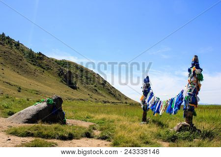 Colorful Buddhist Prayer Flags Hadags On Ritual Shamanic Poles Near The Buha Shuluun Which Translate