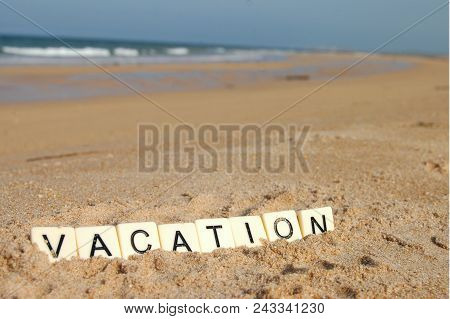 Letters Of Vacation On A Sunny Beach With Sea In Background