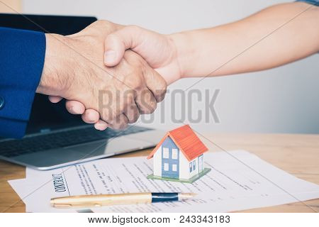 Real Estate Agent Shaking Hands To His Client After Signing Contract Agreement In Office,concept For