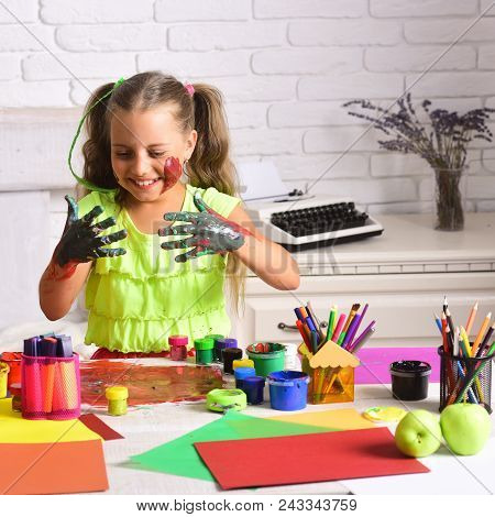 Girl Painter Painting With Gouache Paints On Table. Child Happy Smiling With Colored Hands. Arts And