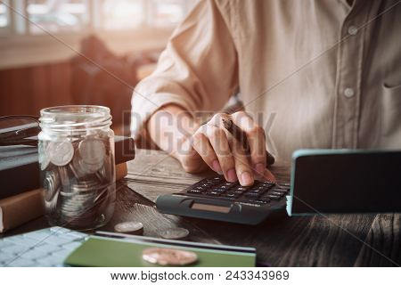 Close Up Asian Business Woman Using A Calculator To Calculate The Numbers.business Finances And Acco