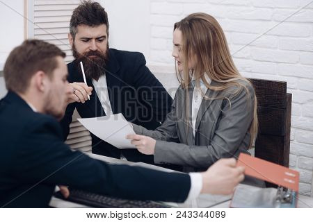 Business Negotiations, Discuss Working Tasks. Office Atmosphere Concept. Business Colleagues At Meet