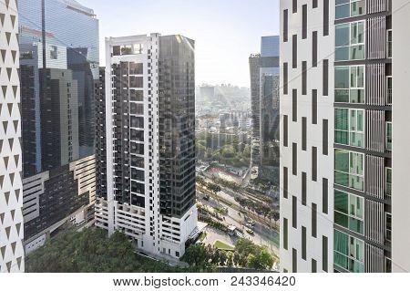 Condominium building with blue sky at Bangkok, Thailand poster