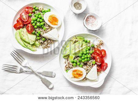 Savory  Breakfast Grain Bowl. Balanced Buddha Bowl With Quinoa, Egg, Avocado, Tomato, Green Pea On L