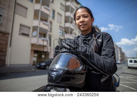 Woman With A Black Helmet On A Motorbike