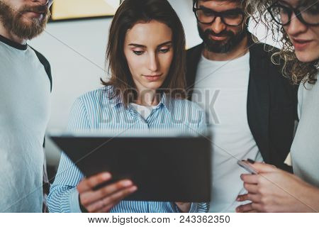 Working Process Photo.group Of Young Coworkers Using Electronic Gadgets Together At Modern Office Lo