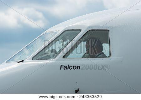 Berlin - April 26, 2018: Pilot In The Cockpit Of Business Jet Dassault Falcon 2000lxs. Exhibition Il