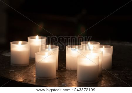 Lighting Prayer Candles In A Church Prayer Candles In A Church. Memorial Candles In A Church