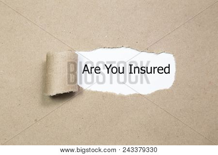 Are You Insured Written Under Torn Paper. Insurance Concept