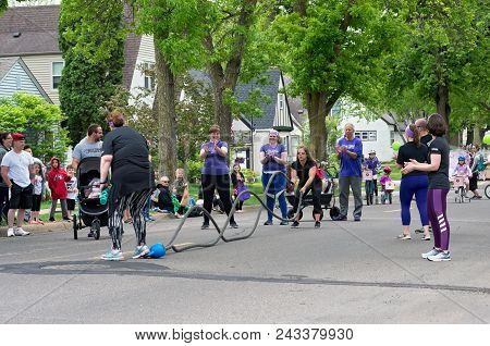 West Saint Paul, Minnesota, Usa - May 19, 2018: Woman In The Street Using Battle Ropes For Fitness T