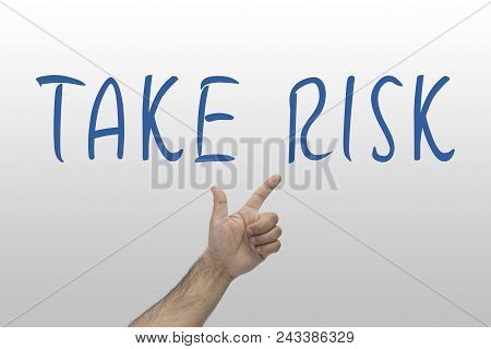 Business, Risk Concept. Hand Pointing Take Risk Word On Whiteboard