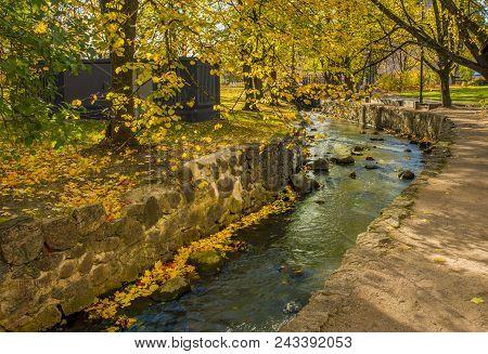 Autumnal Park With Small Brook In Kuldiga City, Latvia, Europe