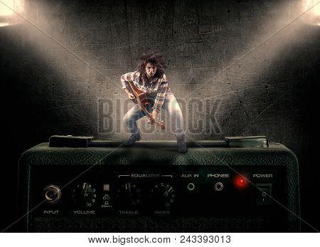 The Artist Play Guitar On Amplifier Festival
