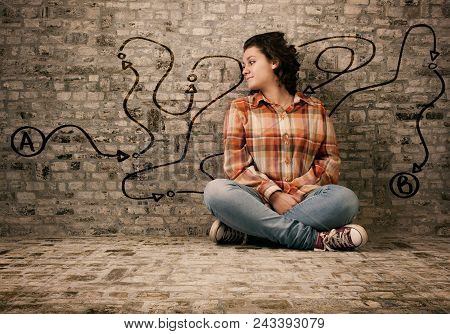 Young Woman Sits On A Concrete And Looking To Path Drawn On Wall , Point A To Point B.