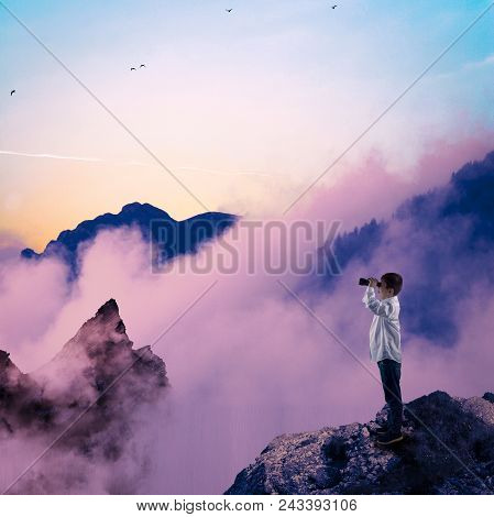Kid On The Peak Of A Mountains And Looking Through Binoculars .