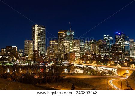 Calgary Downtown Skyline At Sunset Blue Hour Showing Centre Street Bridge Across The Bow River And S