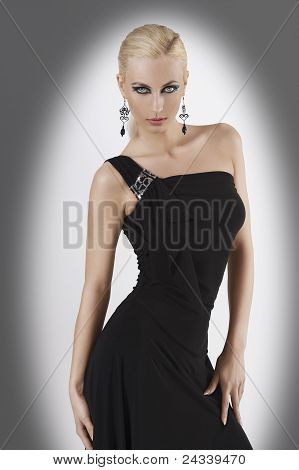 Blond Girl In Black Dress With Sexy Pose