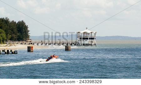 Labuan,malaysia-feb 2,2018:water Taxi Boat Service With Background Of The Iconic Floating Restaurant