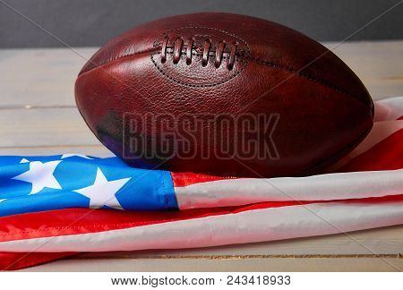 American Football Ball And Old Glory Flag. Copy Space. Usa. Patriotic.
