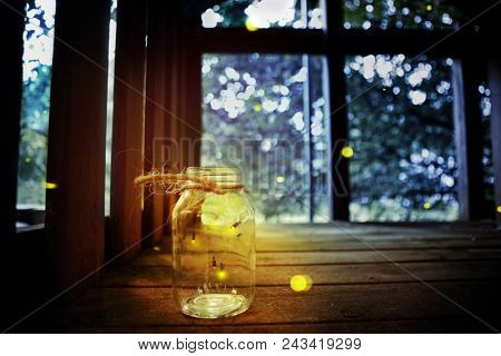 Fireflies in a jar in a child's tree fort