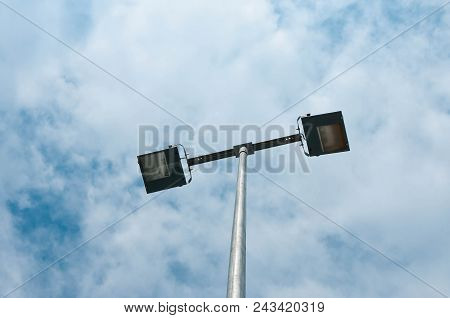 Street Lamppost Close Up Shot, Blue Sky With White Clouds Background.