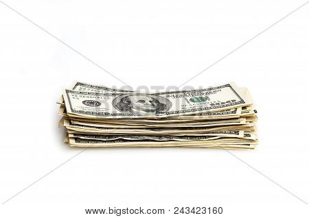 A Stack Of One Hundred Dollar Bills On A White Background. Isolated.