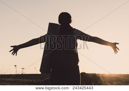 Lonely Female Traveller Standing With Open Arms Opposite To The Sunset. Concept Of The Vacation, Tra