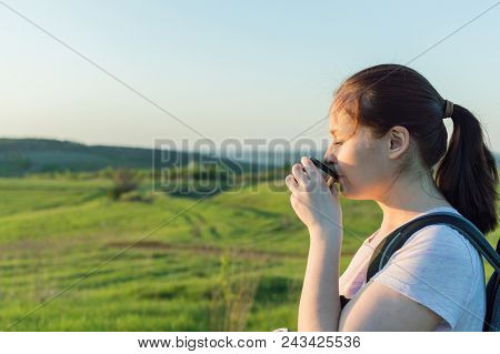 Young Female Traveller Is Drinking A Coffee From The Travel Metallic Cup In The Morning. Concept Of