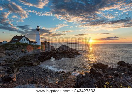 Portland Lighthouse At Sunrise In Cape Elizabeth, New England, Maine, Usa.