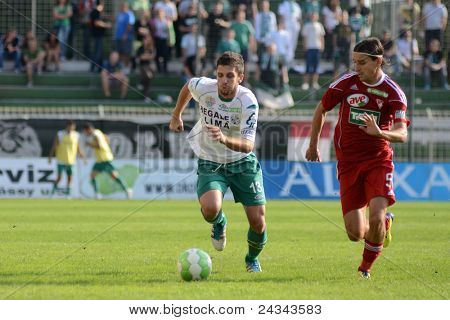 KAPOSVAR, HUNGARY - SEPTEMBER 24: Okuka Drazen (white 13) in action at a Hungarian National Championship soccer game - Kaposvar (white) vs Debrecen (red) on September 24, 2011 in Kaposvar, Hungary.