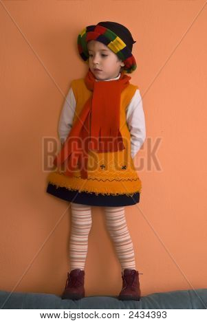 Litle Girl In Orange Dress Looking