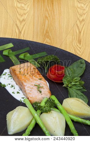 Delicious Fried Salmon Fillet Seasonings On Wooden Floor Background. Cooked Salmon Steak With Pepper