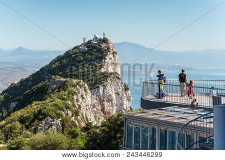 Gibraltar, Uk - May 18, 2017: Tourists And Barbary Apes On The Viewing Platform With The Rock And Th