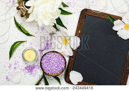 Top View Of Spa Theme Objects, Fresh White Peony Flowers With Black Chalkboard Background Card Conce