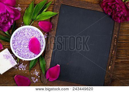 Spa Theme Objects Bath Salt, Fresh Purple Peony Flowers With Black Chalkboard Background Card Concep